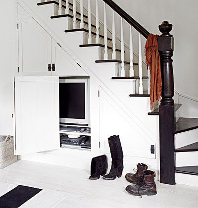 """Hiding the entertainment center is a dilemma in almost every living room, but these homeowners took the right approach and cleverly hid their flat screen TV under the stairs."" Inspiration by My Home Ideas."