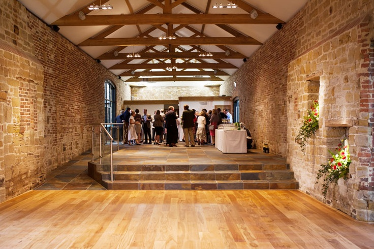 Hendall - The Stone Barn Reception Venue Sussex - gorgeous! Love the mix of brick and stone walls, and wood and stone floors.
