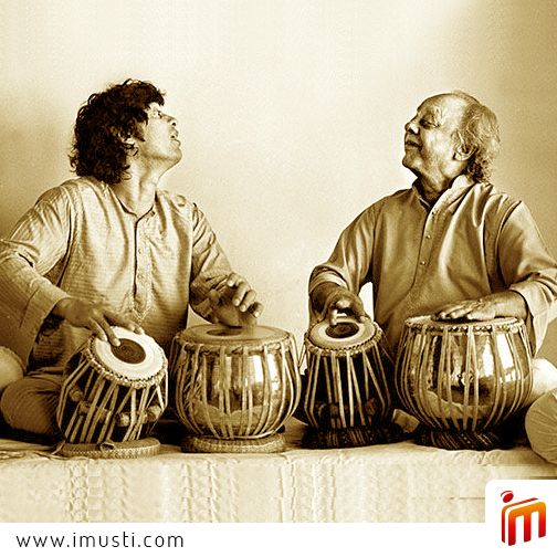 Here is the magical father-son duo of Ustad Allah Rakha Khan and Ustad Zakir Hussain together.  Enjoy the magic and share it with others as well.