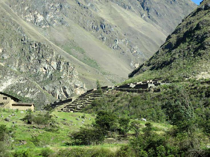 Leaving Machu Picchu by train, along the Urubamba River. Inca terraces and scree slopes.
