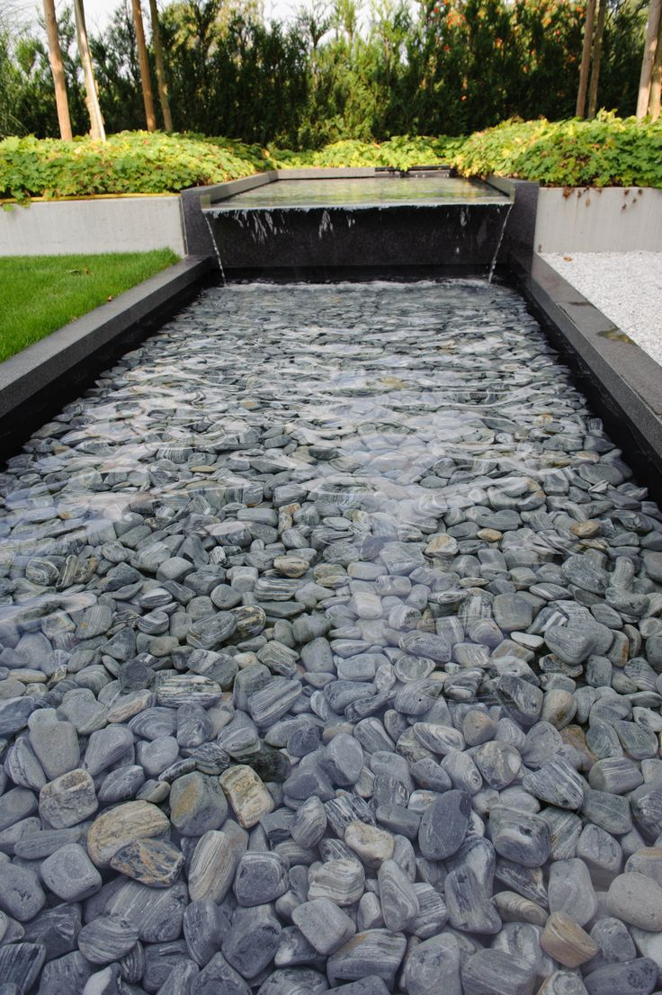 Black and Silver Grey Cobbles (fish friendly) come in 40 -90mm and can be ordered in Bulk or bags | modern water feature