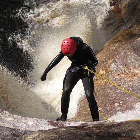 Abseiling down a waterfall, Machinery Canyon Tasmania