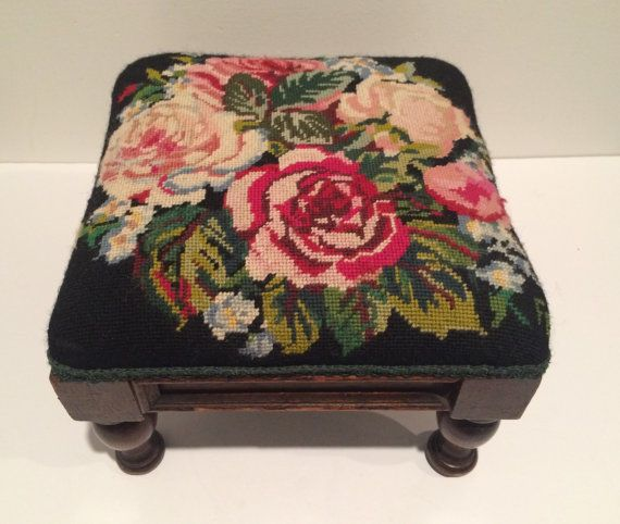 What a classic little stool! It has sturdy but shapely legs and interesting details to the side panels. The beautifully stitched wool needlepoint