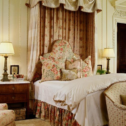 Formal traditional bedroom with attractive bedding & bed hangings.