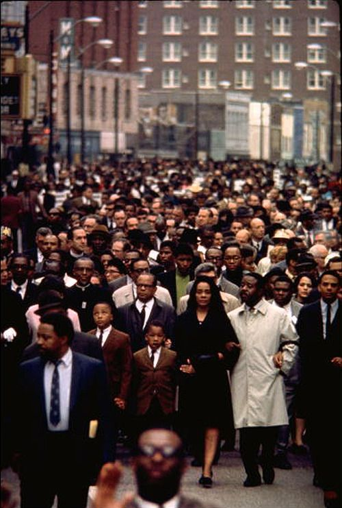 April 4, 1968: Civil rights leader, MLK Jr. was shot to death at a hotel in Memphis. The official story was a single shot fired by James Earl Ray from 200 feet away at a nearby motel struck King in the neck.  Photo: Ralph Abernathy, with Mrs. King and her children lead a massive march through through the streets of Memphis.