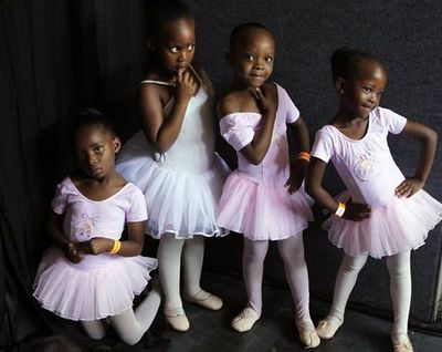 Budding ballerinas pose before dancing on stage in Johannesburg. They are part of a South African Mzansi Ballet program that teaches some of the city's poorest children to dance, free of charge.    Photo: Denis Farrell, Associated Press / SF (via Day in Pictures, Nov. 19, 2012 - SFGate)