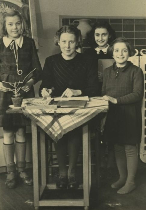 Anne Frank, second from right. This was taken in her old classroom in the Montessori school (now The Anne Frank School), she attended until 1941 when she was move to the Jewish Lyceum. The classroom Anne studied in for all those years is still in use and is still the same layout as the classroom Anne knew.