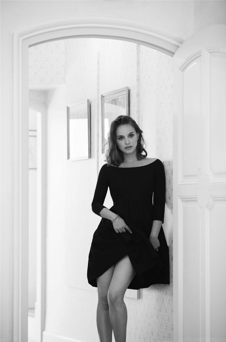 Photographed in black and white, Natalie Portman wears a cocktail dress