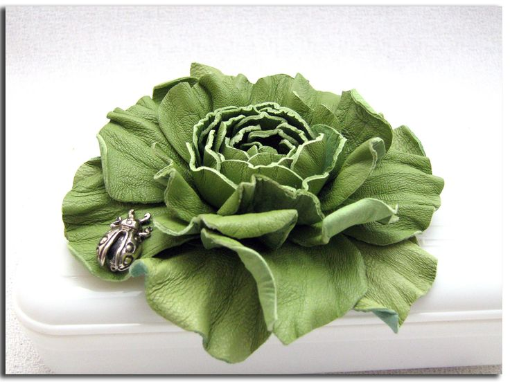 Handcrafted green leather rose (flowers, accessories, brooches, suede, DIY, silver charm, ladybug)   http://www.leatherblooms.com/2013/03/18/repetition-week/