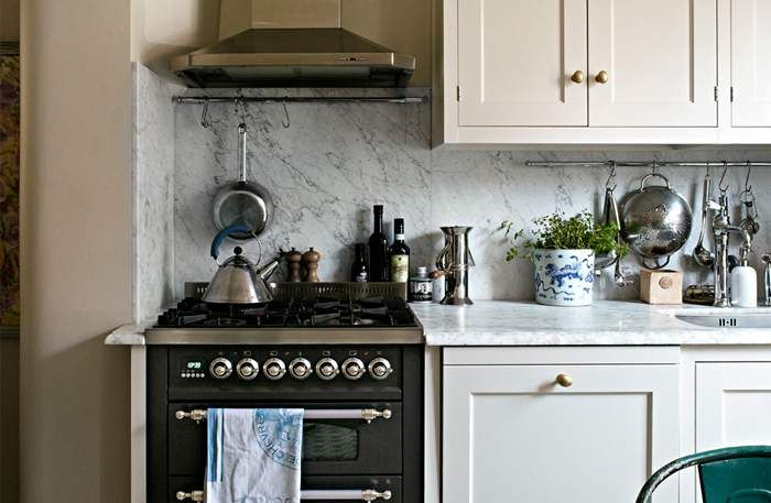 Stove, floors, cabinets...such a cute kitchen!