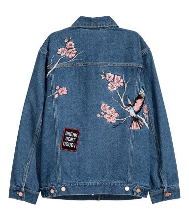 Dark denim blue. Jacket in washed denim with embroidery and embroidered appliqués. Collar, buttons at front, wide cuffs, and chest pockets with flap and