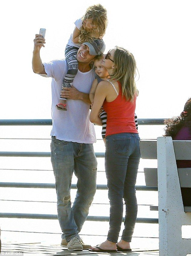 Growing family: Cam and Dominique are shown in July 2014 with children Everleigh and Rekker in Santa Monica, California