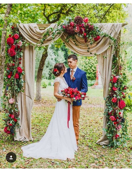 Red fall floral wedding arch / http://www.himisspuff.com/fall-wedding-arch-and-altar-ideas/