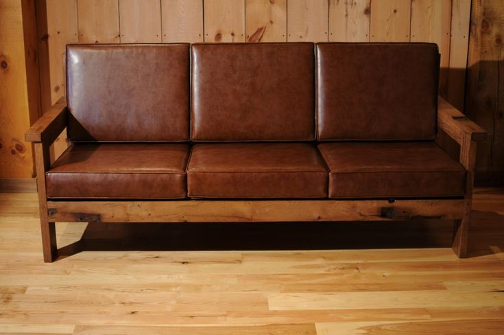 Reclaimed wood frame couch with leather cushions misc