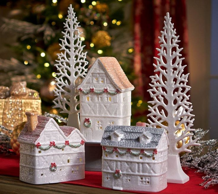 This 5 piece Glittered Village has illuminated buildings.  H206646 http://qvc.co/-Shop-ValerieParrHill