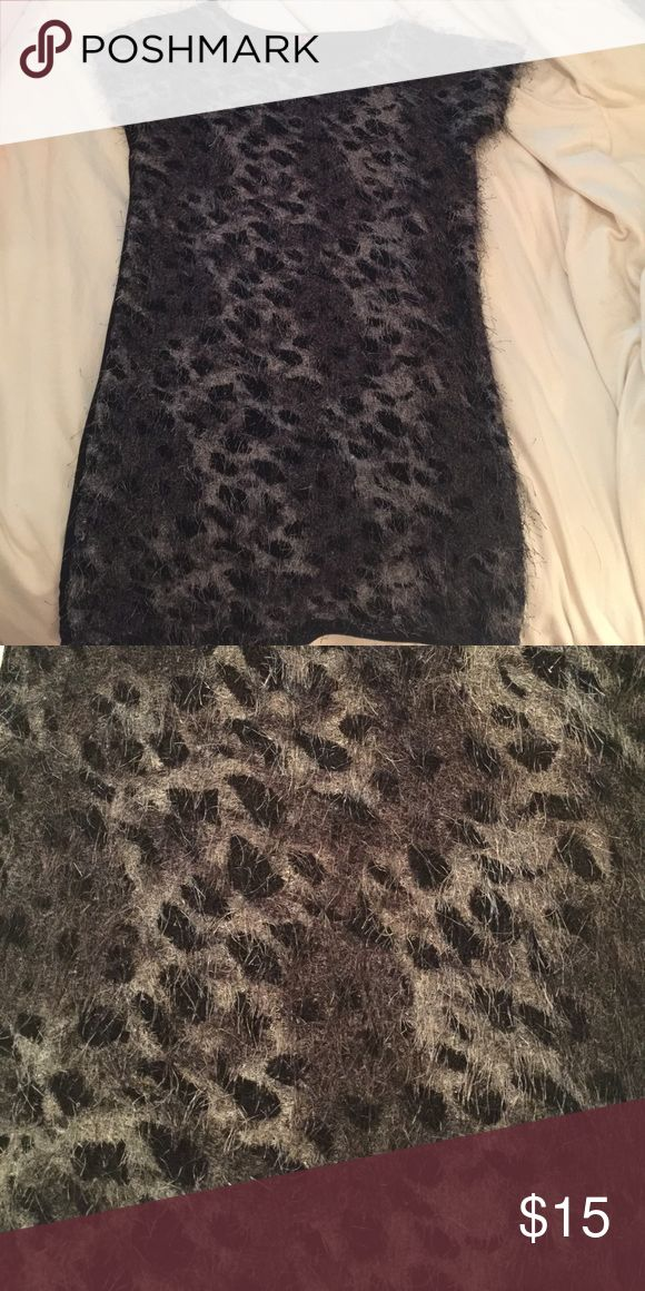"""""""Shaggy"""" dress This dress is """"shaggy"""" on the front. The back of the dress is black. It's not super tight fitting, a little looser. Worn once for New Years! Dresses Mini"""