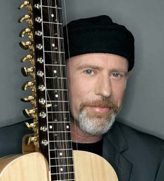 Harry Manx. Probably the biggest proponent in the West of the Mohan Veena, a sitar/guitar hybrid.