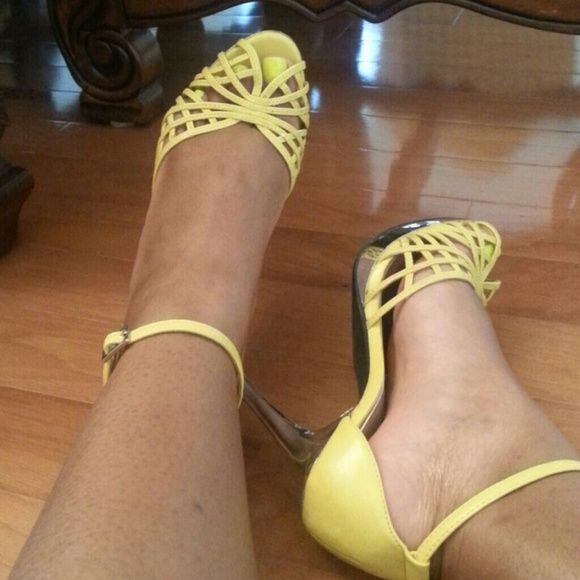 Yellow sandal heels Ready to shine?!? Walk in these cute yellow heels and you're sure to make a statement! There are a couple of scuff marks as the shoes are pre-loved but still in good condition. Ide continue to wear them but I have too many yellow ones. Rouge Shoes Heels