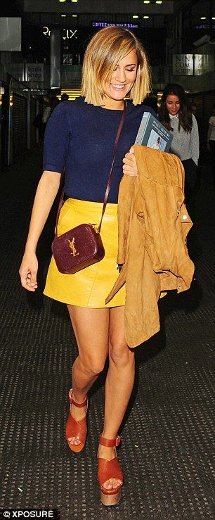 Party look: The new X Factor host showed off her legs in a yellow leather mini skirt teame...