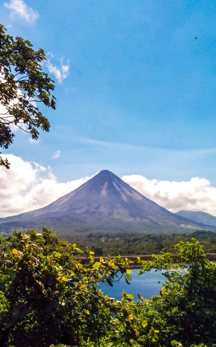 Arenal Volcano, Costa Rica. Read our guide to visiting Arenal Volcano National Park: http://mytanfeet.com/costa-rica-national-park/arenal-volcano-national-park/