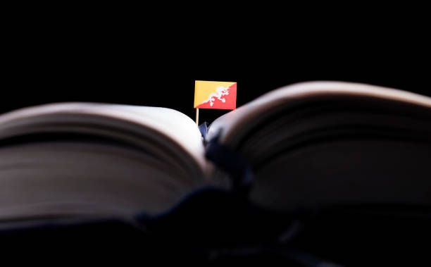 bhutan flag in the middle of the book knowledge and education concept