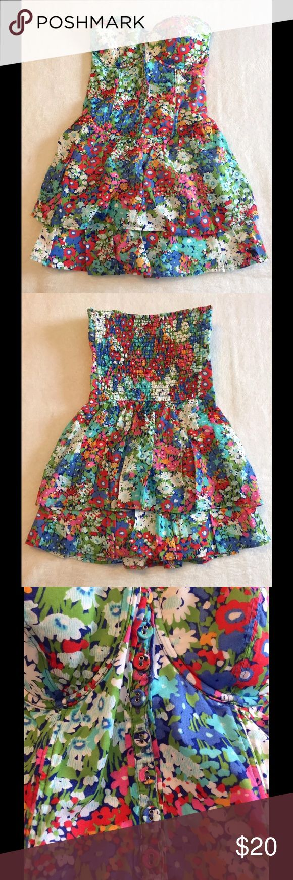 Abercrombie Fitch Strapless Floral Bustier Corset Abercrombie Fitch Strapless Top   Corset Bustier style  Button down front  Underwire lined cups  Stretchy back  Whole top is lined  Pretty Floral pattern  Two ruffles  Excellent condition Abercrombie & Fitch Tops Blouses