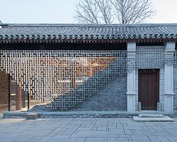 kengo kuma adds jig-saw aluminum screen to traditional beijing building