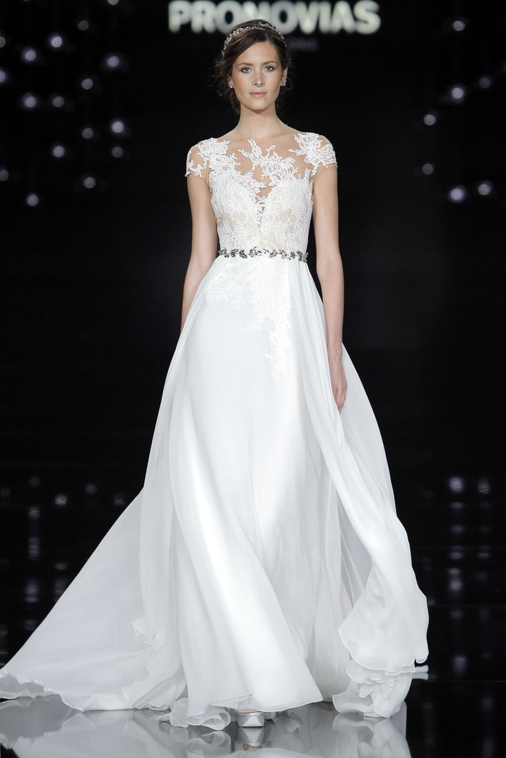 Lourde Couteron in Nubio dress made of silk chiffon, tulle and embroidery.