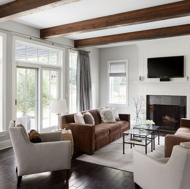 home : livingroom etc Stunning ceiling beams bring warmth and texture to this gray living room.| Summit Signature Homes, Inc.