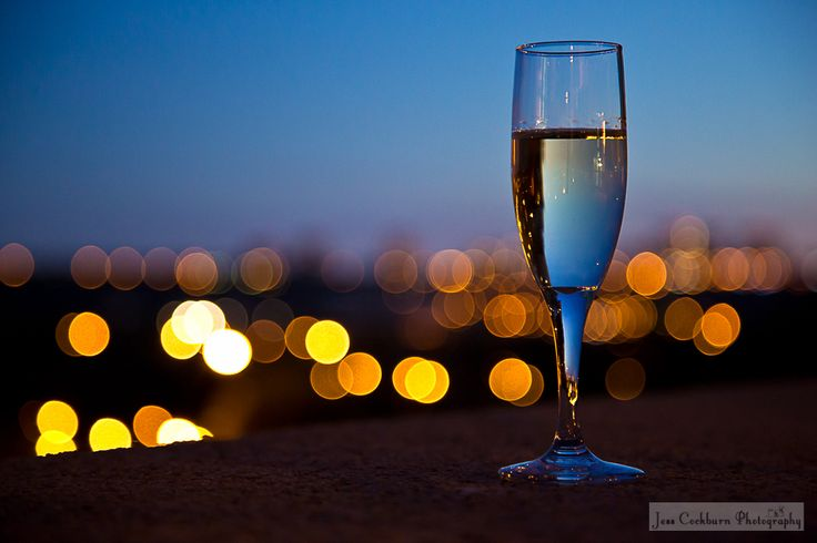 Sparkling champagne in front of some sparkling city lights!