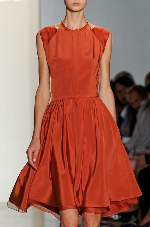 That little persimmon colored dress