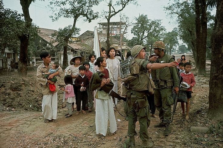 https://flic.kr/p/K3oi9F | Vietnam War - Hue 1968 - Civilians with Marines During Battle of Hue - Photo by Kyoichi Sawada | 01 Feb 1968, Hue, South Vietnam --- 2/1/1968-Hue, South Vietnam: Civlians carrying a white flag approach U.S. Marines, following a lull in street fighting between Allied units and the Viet Cong. Many civilians were driven from their homes in the bloody street fighting in this ancient city. --- Image by © Bettmann/CORBIS