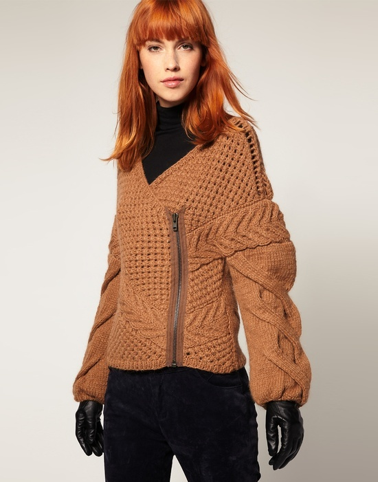 That is not fashion. That is a series of knitting errors.