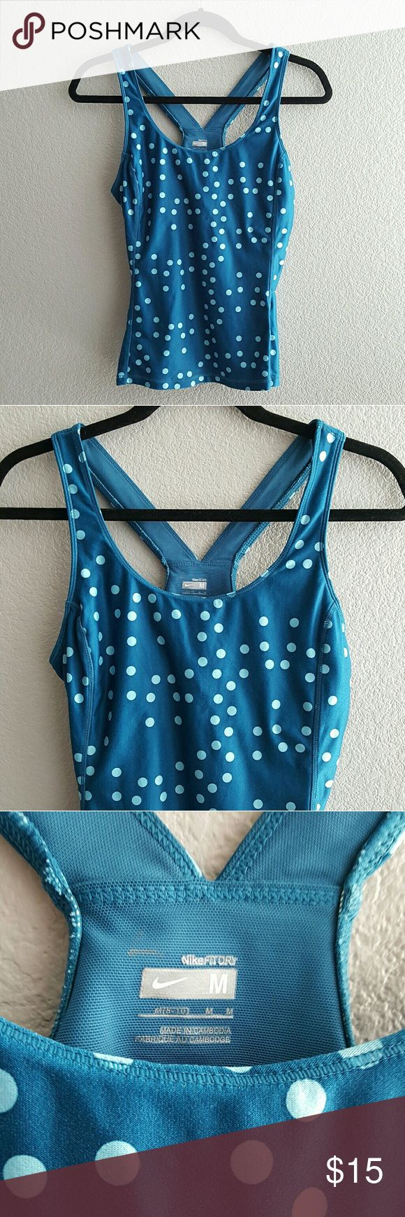 Nike Polka Dot Exercise Tank Super cute blue racerback tank with lighter blue polka dots from Nike Fit Dry, size medium. Tank does include built-in bra. In overall really good used condition with no stains or holes.  Comes from a smoke free home! I always ship same or next day :) Nike Tops Tank Tops