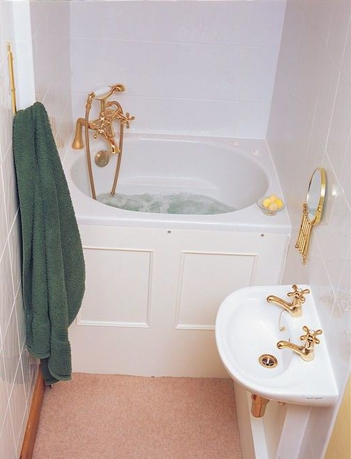 Small Bathroom Idea With Corner Deep Tub Gold Tone Faucet Stand Basin For Double Faucets A Decorative Mirror