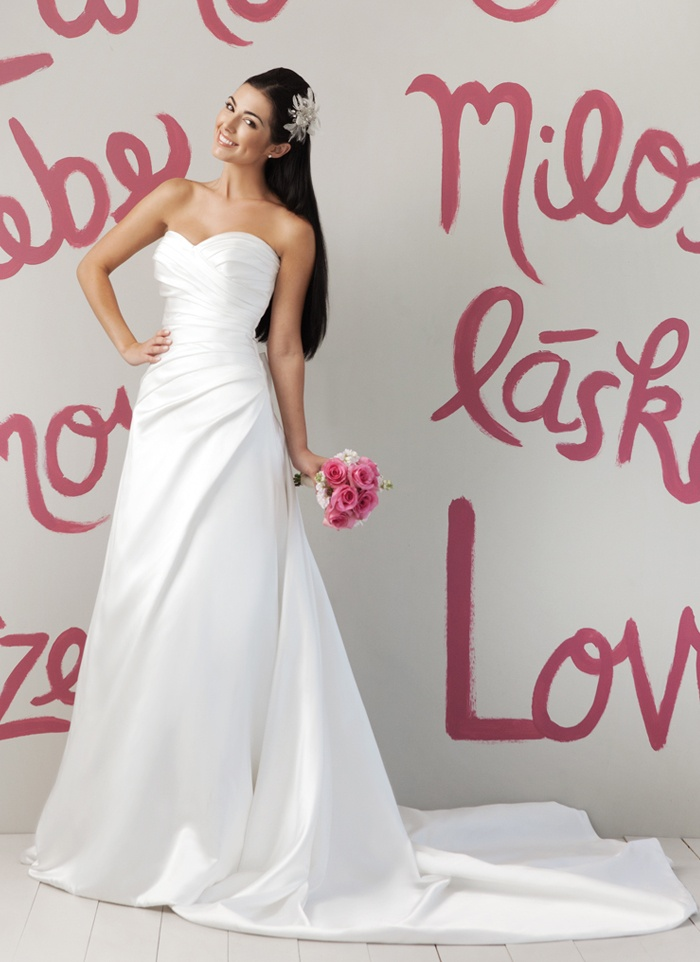 Sweetheart Gowns 5963. Regal satin asymmetrical pleated dress
