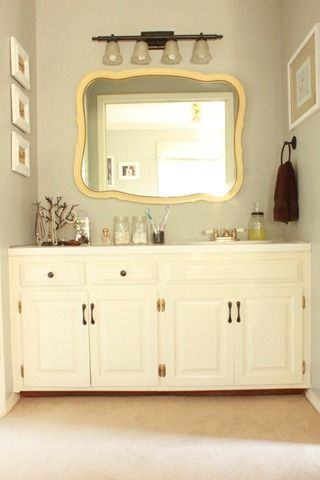 one day bathroom reno grey paint spray painted hardware and a new mirror transformed this bathroom