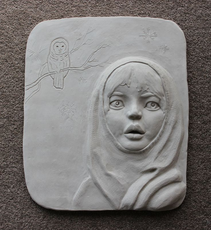 """Bas relief """"Winter Maid"""" from Seasons Collection, hand built in white stoneware clay and fired."""