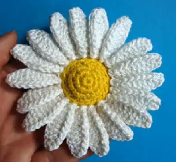 How To Crochet A Daisy by Jeny (secretsof100). No dialogue, just watch, and it's not crocheted at warp speed so you can't follow.