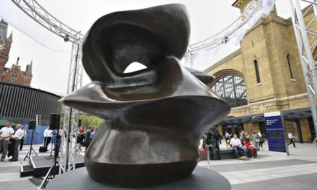 Henry Moore's 1974 bronze sculpture, Large Spindle Piece, is unveiled outside King's Cross station. Photograph: Philip Toscano/PA
