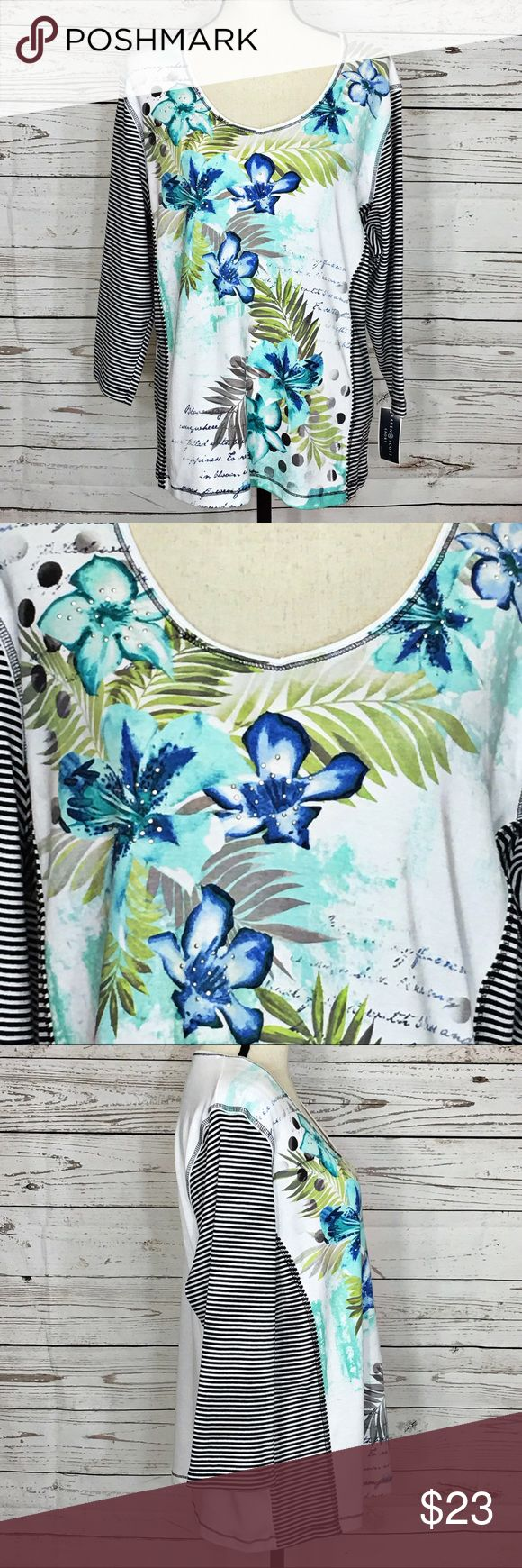 """Karen Scott Sport Floral Striped 3/4 Sleeve Blouse Beautiful teal, blue, green and white embellished stretchy blouse with black and white striped 3/4 sleeves. New with tags. Bust: 46""""; Length in the back from the shoulder: 26"""". Measurements are approximate. Smoke free home. 🌺Thank you for shopping my closet 😊🌺 Karen Scott Tops Blouses"""