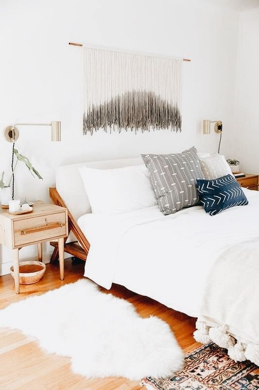 Looove that piece above the bed and grey pillow brow together