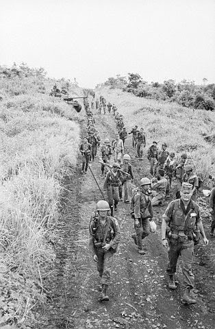 Vietnamese troops, led by American Advisor Norman Scwarzkopf, march toward Pleiku, after clearing Highway 19 from Duc Co of Viet Cong August 18