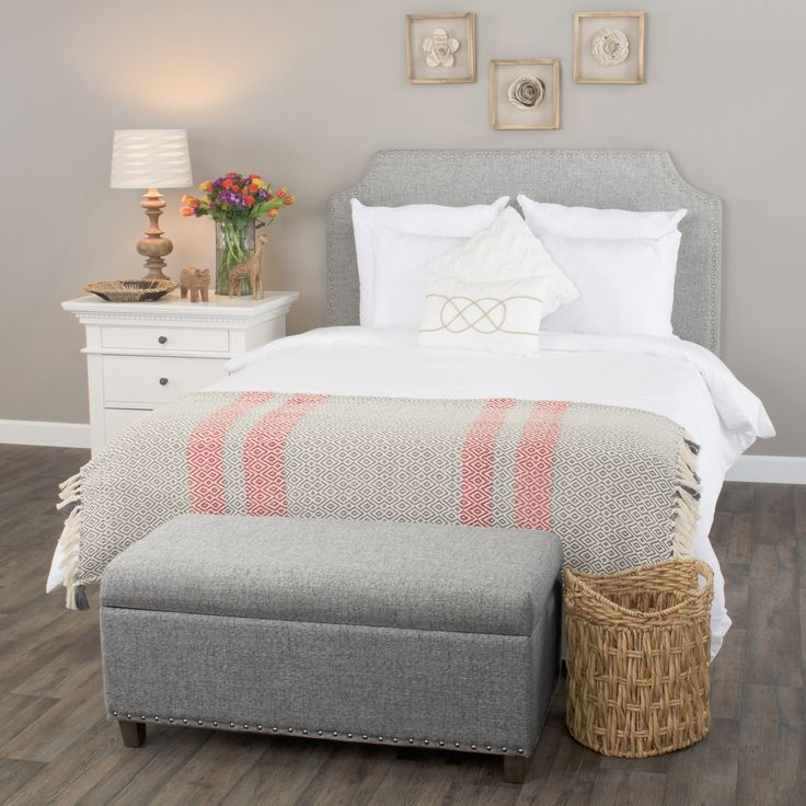 This transitional headboard features unique scooped shape cutouts on each side to create a stunning design feature. Elegant nail head trim is showcased along all of the edge for a classic tailored look. The slubby linen weave fabric has a relaxed and organic feel and is offered in three soothing colors. The unique design will work with both a full size or queen size bed frame.   This headboard attaches to a standard frame using your existing hardware (frame and hardware not included)…