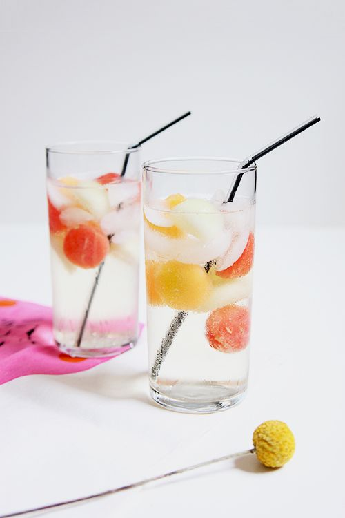 Melon Ball Cocktail - the link is for a wine-based recipe, and I hate wine, but I love the idea of melon balls floating in a clear-spirit cocktail.