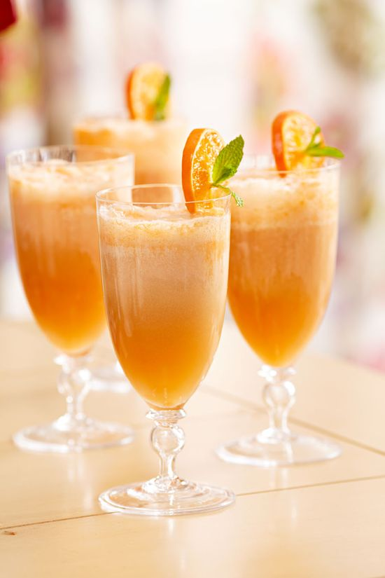 Orange Dream Mimosas  • 8 cups chilled Champagne  • 2cups orange sherbet  • 1cup whipping cream, whipped to soft peaks  • 8mint sprigs  • 2tangerines or Clementines, sliced
