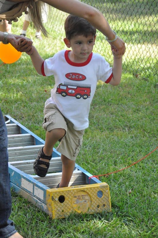 """Per original blog """"The Little Nook"""":  """"we went outside to """"save the kitten from the tree"""", but first they had to climb the ladder, jump through burning hoops, and then put the fire out with water balloons!"""""""