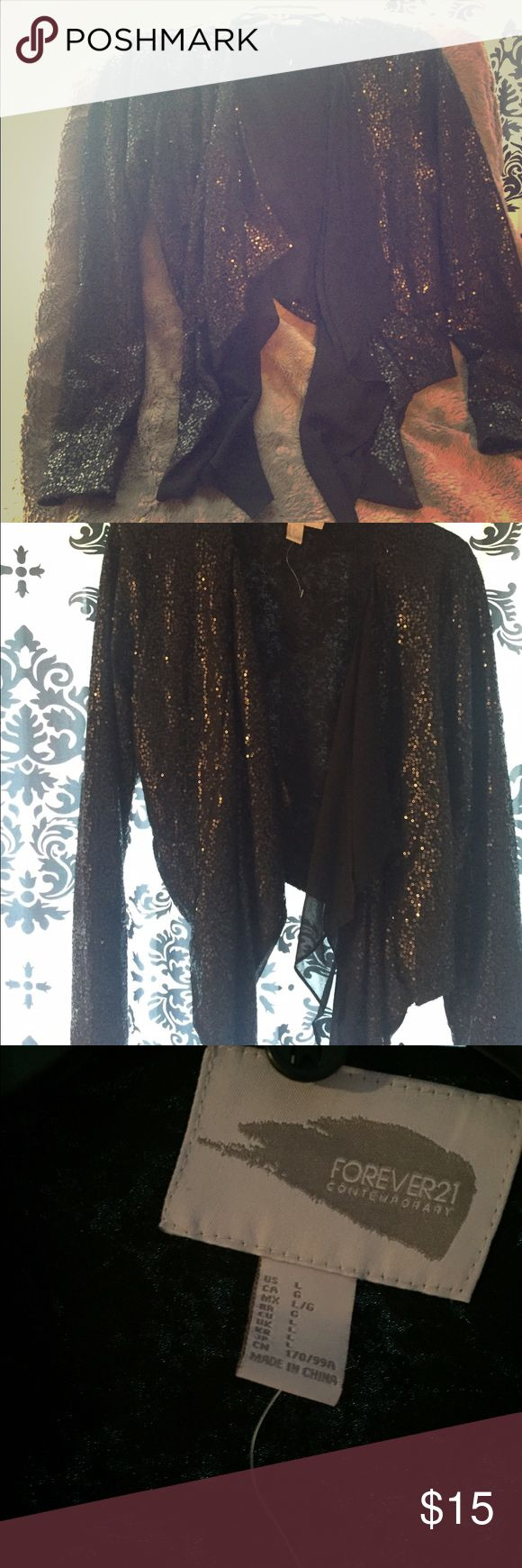 Black Sequin Blazer Tiered black sequin blazer. Forever 21 Jackets & Coats Blazers