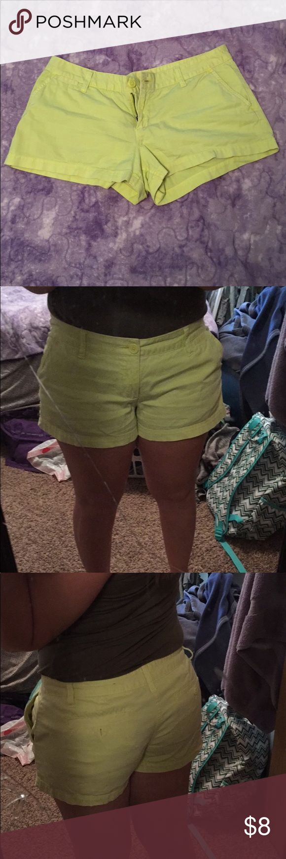 Neon Yellow Shorts These shorts are a light neon yellow. Size 11 in juniors, medium fit. Zipper and buttons are all good. There is not much stretch and the style resembles a pair of khakis. Shorts