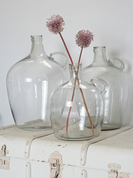 Retro Glass Flagon    Reminiscent of bottles from your grandma's scullery, our clear glass vessels look particularly good filled with long-stemmed flowers plucked from the garden.  When arranged together, their three generous sizes make an instantly pleasing display.    Available in 3 sizes:   Medium - 28xH34cm  Large - 30xH44cm  Extra Large - 30xH50cm    Item	Price	 	Qty  Medium [55351]	£39.95		  Large [55353]	£45.00		  Extra Large [55352]	£52.00